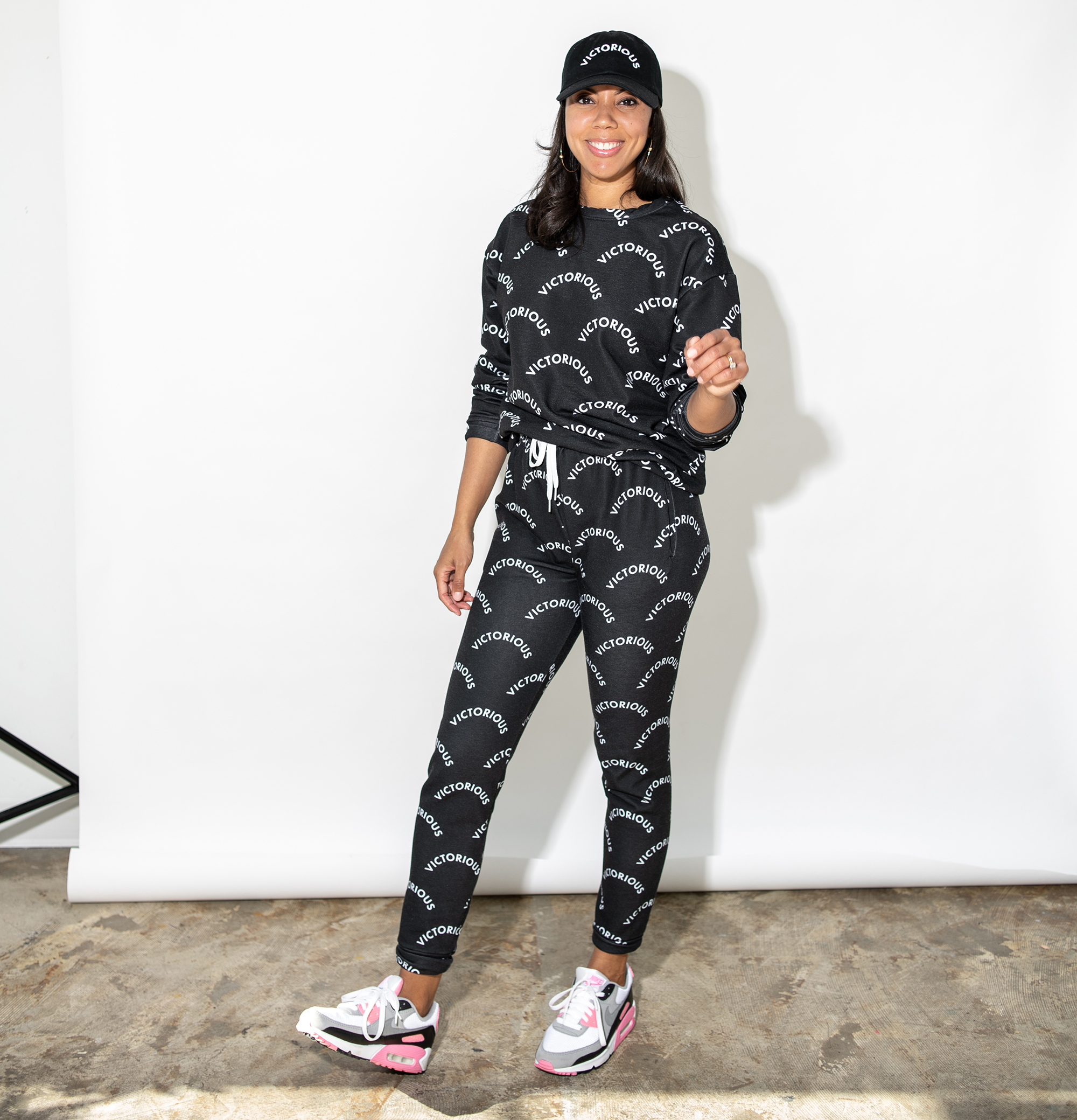 Dionna Dorsey in District of Clothing 'Victorious' sweatshirt, joggers and hat.