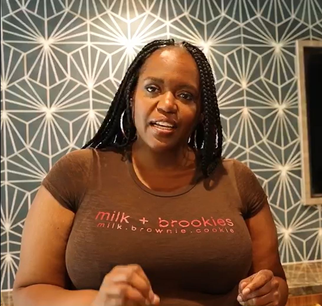 Dionna Dorsey sitting at desk.